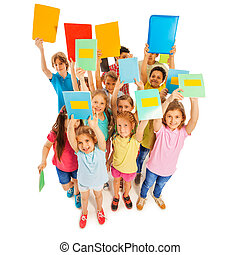 Group portrait of cool and confident 8 years old students lifting textbooks isolated on white