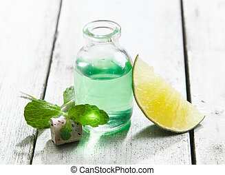 Cool and refreshing mint essential oil in a clear glass ...
