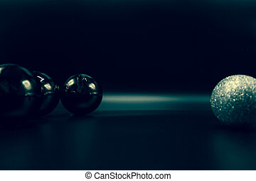 Cool black and glittered silver Christmas balls on black.