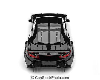 Cool black sports super car - top down back view