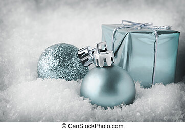 Cool Blue Christmas Decorations in Snow - An arrangement of...