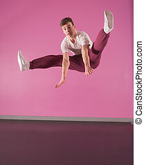 Cool break dancer mid air doing the splits in the dance...