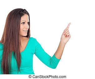 Cool brunette girl inidicating something with her finger