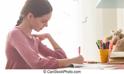 cool brunette girl with pigtail - I'm doing my homework ....