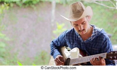 cool caucasian man playing guitar