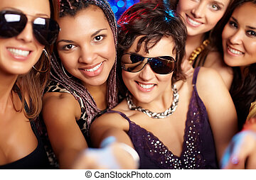 Cool clubbers - Close-up shot of group of partying girls...