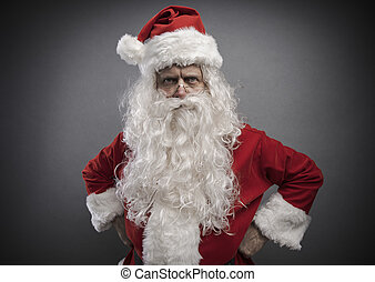 Cool confident Santa posing with arms akimbo and looking at camera, Christmas character