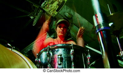 Cool drummer - Beautiful girl in a cap sits and plays drums....