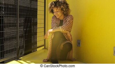 Cool ethnic woman posing on street - Stylish confident ...