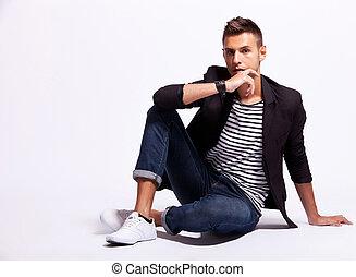 cool fashion male model sitting