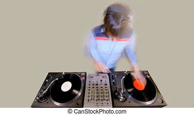 cool female dj behind the turntables