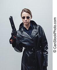 Cool female spy holding a gun