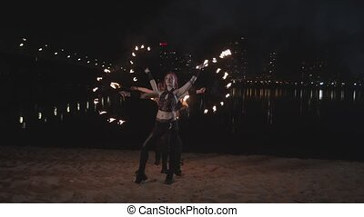 Cool fireshow artists juggling standing on by one - Skillful...