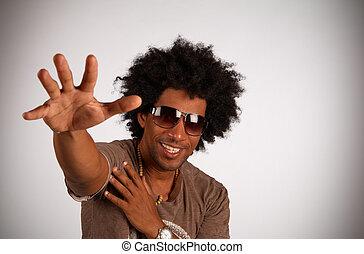 African american hiphop artist in cool gesture
