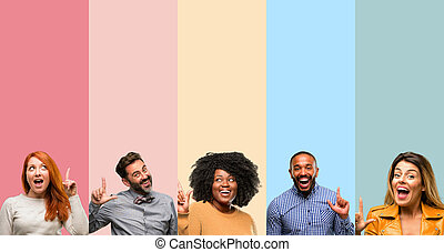 Cool group of people, woman and man pointing away side with finger