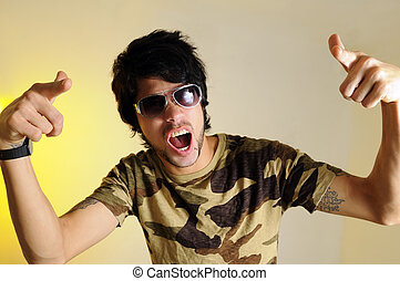 Cool guy gesturing - Portrait of crazy young man yelling and...