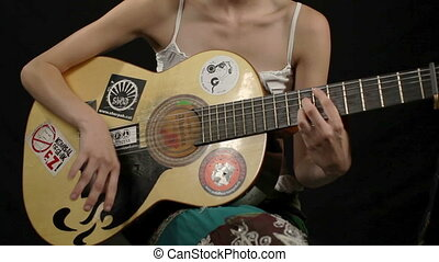 cool gypsy style woman plays guitar, including high quality audio captured with the zoom H4 microphone