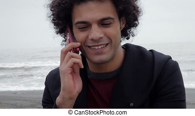 handsome man talking on the phone