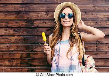 Cool hipster student woman wearing eyewear glasses . Caucasian female university student looking at camera smiling happy.