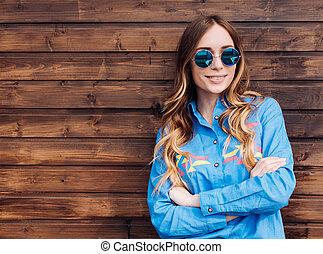 Cool hipster student woman wearing eyewear glasses .