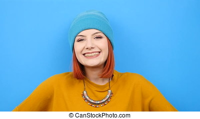 Cool hipster woman smiling at the camera