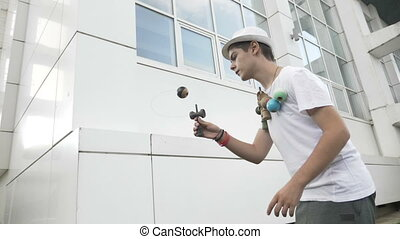Cool kid catching kendama ball on spike progressing to a...