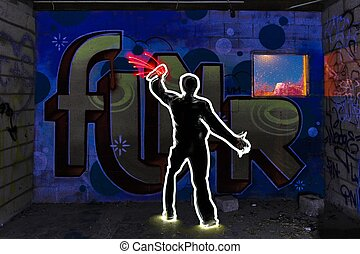 Cool Light Painted Image of Man Tagging with Spray Paint