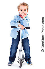 Cool little boy with his scooter