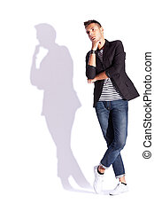 cool looking shadow of a young casual man