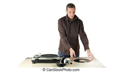 cool male dj behind the turntables