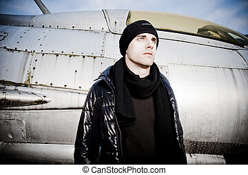 Cool Man and a Fighter Plane - Cool Man standing in front of...