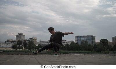Cool man dancing breakdance - A man is dancing a break dance...