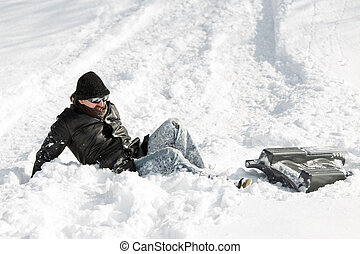 man falling from a sledge after a sleigh ride in deep snow