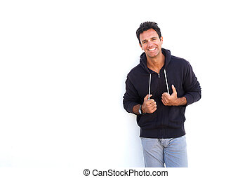 Cool middle aged man smiling against white background