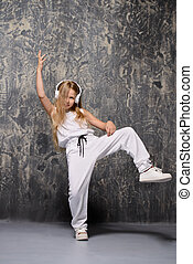64c027128159 Hip hop or break dancing girl performs face stand.