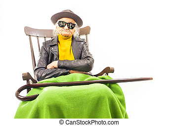 Cool old woman with sunglasses and hat.