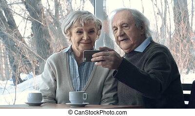 Cool Seniors - Close up of seniors making selfie in...