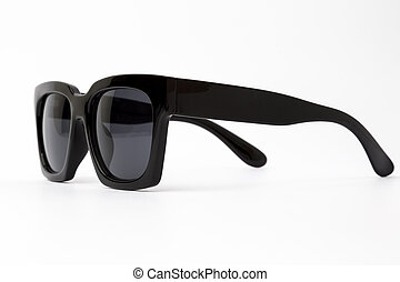 Cool sunglasses with black plastic frame isolated on white background.