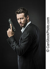 Cool undercover agent with gun - Confident undercover agent...