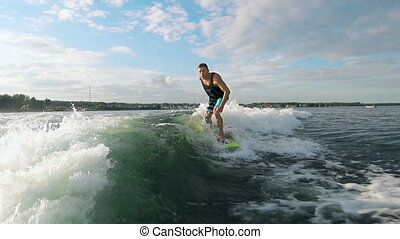Cool Wakesurfer - Young guy wake surfing on the lake