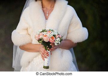 cool wedding bouquet in hands of the bride