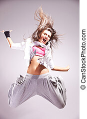 cool woman dancer jumping in mid air making a nice pose