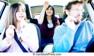 Cool women and man in car dancing