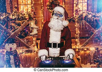 cool x-mas party - DJ Santa Claus in luminous glasses and...