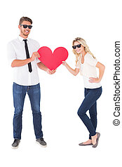 Cool young couple holding red heart