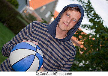 Cool young man with basketball