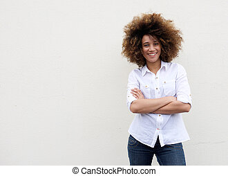 Cool young woman smiling with arms crossed