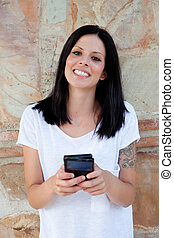 Cool young woman with mobile