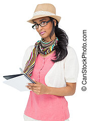 Cool young woman writing in notepad