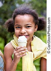 Portrait of pretty girl eating ice-cream